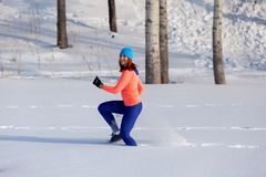 Young woman running in winter stock photos