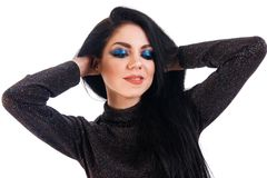 Young woman with a bright blue makeup Stock Images
