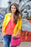 Young woman in bright clothes posing outdoors Royalty Free Stock Photography