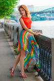 Young woman in bright dress on the waterfront Stock Image