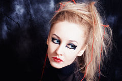 Young woman with bright gothic makeup Stock Photos