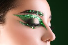 Young woman with bright green makeup Royalty Free Stock Photography