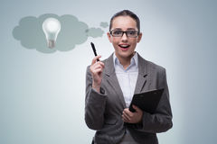 The young woman in bright idea concept Stock Images