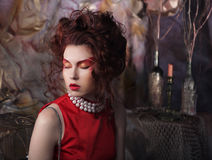 Young woman with bright make-up on a background of theatrical sc Stock Photography