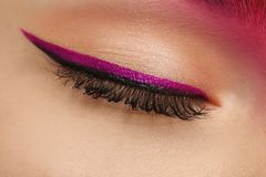 Young woman with bright makeup,. Closeup stock photo
