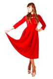 Young woman in a bright red evening dress Royalty Free Stock Image