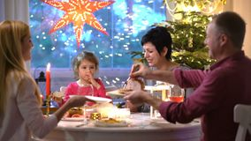 Family Christmas Meal. A young woman Bringing Out Turkey At Family Christmas Meal stock video footage