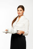 Young woman brings coffee Royalty Free Stock Photography