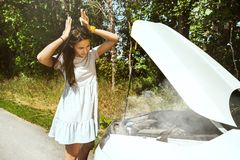 Young woman traveling on the car in sunny day stock images