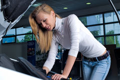 Young woman at broken car Stock Images