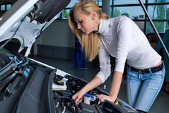 Young woman at broken car royalty free stock photography