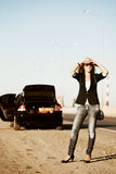 Young woman with a broken car Stock Images