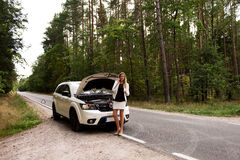 Young woman with broken car calling for help Royalty Free Stock Photos