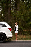 Young woman with broken car calling for help Royalty Free Stock Photo