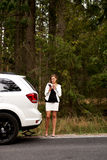 Young woman with broken car calling for help Stock Photos