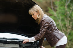 Young woman at broken car Stock Photos