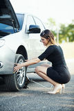 Young woman with broken car Stock Photos