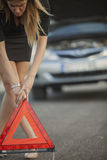 Young woman with broken car Stock Image