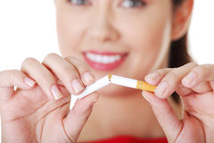 Young woman with broken cigarette. Royalty Free Stock Photo