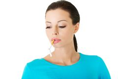 Young woman with broken cigarette in mouth Stock Image