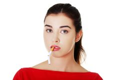 Young woman with broken cigarette in mouth Royalty Free Stock Photo