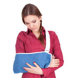 Young woman with broken hand Stock Images