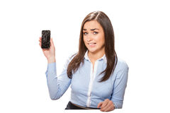 Young woman with broken smartphone. Stock Images