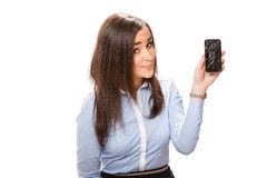 Young woman with broken smartphone. Young businesswoman with broken smartphone royalty free stock photography