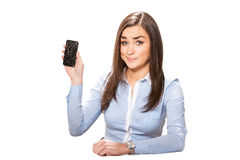Young woman with broken smartphone. Young businesswoman with broken smartphone stock images
