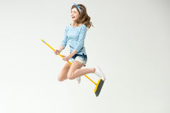 Young woman with broom Royalty Free Stock Image