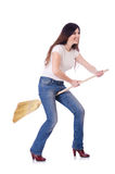 Young woman with broom Royalty Free Stock Images