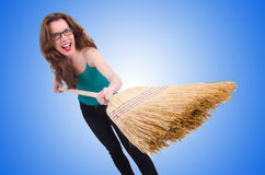 Young woman with broom isolated on white Stock Photos