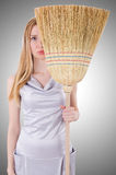 Young woman with broom Royalty Free Stock Photography