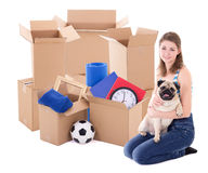Young woman with brown cardboard boxes and dog isolated on white Royalty Free Stock Image