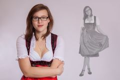 Young woman in Bavarian costume royalty free stock images
