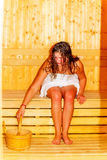Young woman with brown hair enjoying sauna wellness. Royalty Free Stock Images