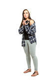 Young woman with brown hair holds camera Stock Photos