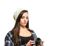 Young woman with brown hair holds camera Royalty Free Stock Images