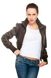Young woman in brown leather jacket. And jeans Stock Photos
