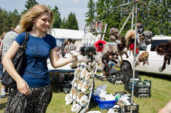Young woman browse fair handmade wares Royalty Free Stock Photography