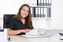Young woman is browsing a file Stock Photography