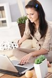 Young woman browsing internet on computer smiling Stock Image