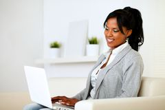 Young woman browsing the Internet on laptop Royalty Free Stock Photo