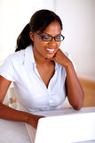 Young woman browsing the internet on laptop Royalty Free Stock Photos