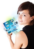 Young woman browsing pictures on modern tablet Stock Image