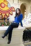 The young woman the brunette in a dark blue jacket Stock Photos
