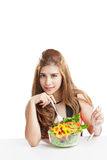 Young woman brunette present and eating salad Royalty Free Stock Photo