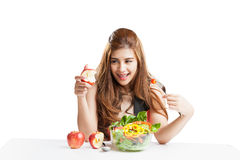 Young woman brunette present and eating salad Royalty Free Stock Photos