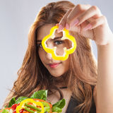 Young woman brunette present and eating salad Stock Photos