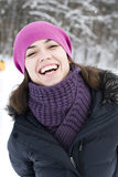 The young woman the brunette in a violet cap laugh Royalty Free Stock Image